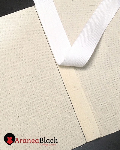 Twill tape positioned over the seam allowance