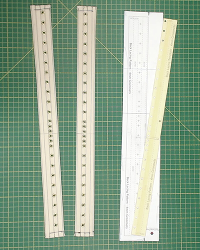 Back lacing strips, pattern and template on a green selfhealing mat