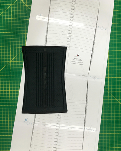 Pattern for the back modesty panel for corsets with a black modesty panel made