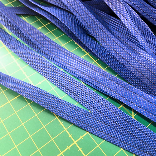 Making folded face mask sewing reinforcing ties