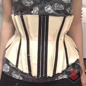 Basic corset mock up front made out of cotton tarp and industrial zip ties
