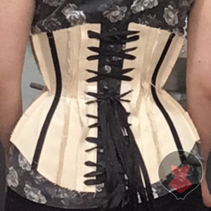 Basic corset mock up back made out of cotton tarp and industrial zip ties