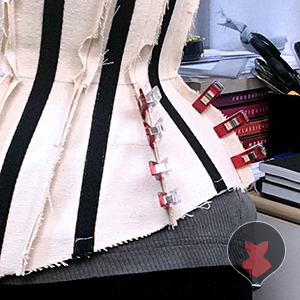 Using more clips to hold corset mock up fit adjustments in place