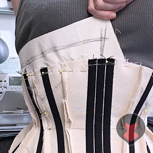 Pulling on to the fabric extension while drawing new edge line