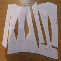 Paper vertical seamed corset pattern pieces prepared for corsetmaking