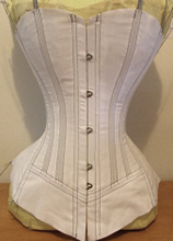 Front side of Mock up of a vertical seamed late victorian corset pattern
