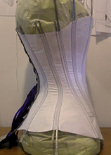 Side of Mock up of a vertical seamed late victorian corset pattern