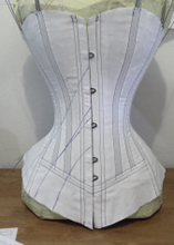Vertical seam victorian corset mock up with more design lines drawn on it building the desired look
