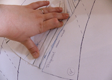Measuring and matching the pattern piece that needs adjustment to the properly shaped pattern piece