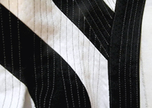 Black and white diagonal corset with loads of boning channels sewn on