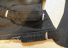 Black suspenders sewn on to the corset edge