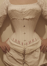 Old vertical corset worn front view