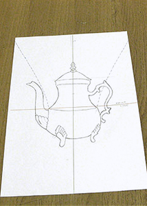 Teapot motif drawn on paper as the center piece for the hand painted corset