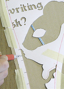 Pattern motifs placed on fabric and secured with masking tape